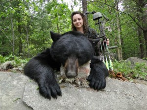 Paige's first bear with a bow