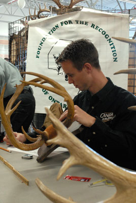Kevin Bealey measures a rack