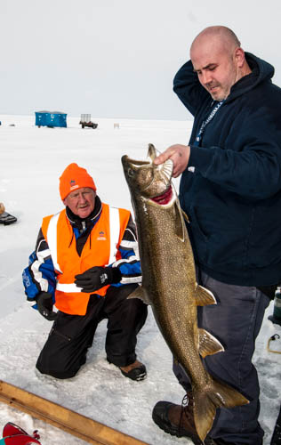 Team 47 Chris Hiltz with his 34 inch Lake Trout