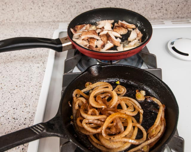 Frying up Shittake Mushrooms and caramelizing sweet onions