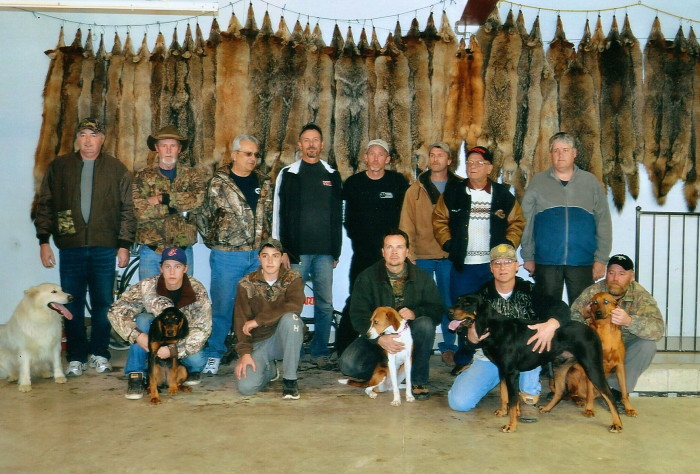 A gathering of local coyote hunters with their bounty of pelts