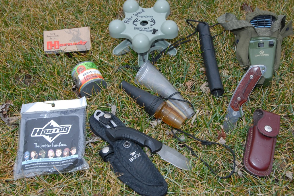 A few items I can depend on when I hunt deer. Buck Knives, Hoorag face scarf,Thero Cell, Primos calls amd Hornady ammo for my Browning slug gun